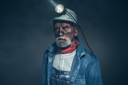 Humorless Bearded Old Miner Staring at the Camera