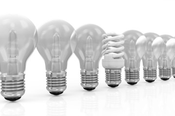 Modern Fluorescent Light Bulb standing out from the others Light Bulbs isolated on white background