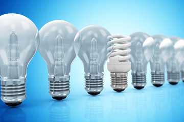 Modern Fluorescent Light Bulb standing out from the others Light Bulbs on blue gradient background