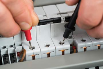 Technician Checking Fuse