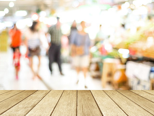 Perspective wood blur market and people with bokeh light