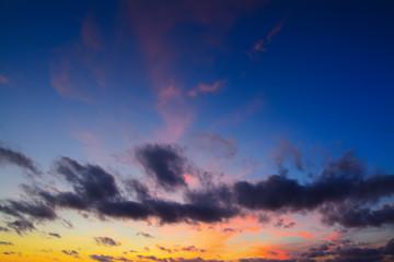 Fotobehang - dark clouds at sunset