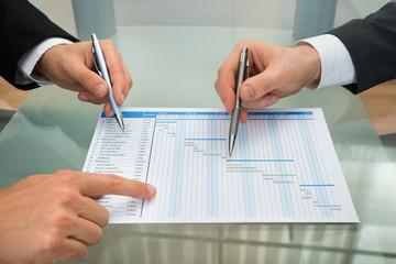 Two Businessmen Making Gantt Diagram