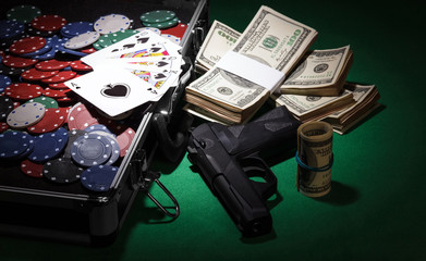 Poker chips and gun