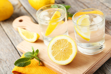 Wall Mural - Fresh lemonade with lemon on grey wooden background