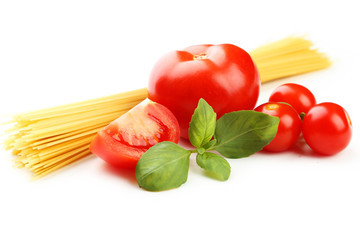 Spaghetti, basil and tomatoes isolated on white
