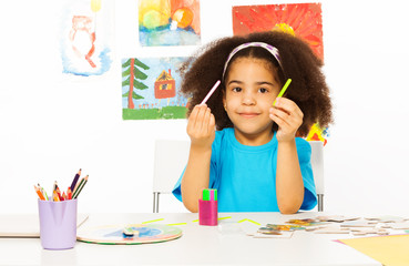 African girl holds cuisenaire rods learn to count