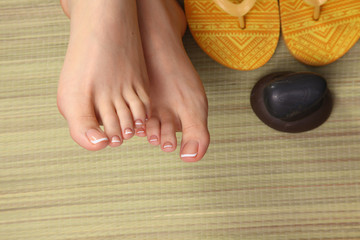 Female feet and  flip-flops