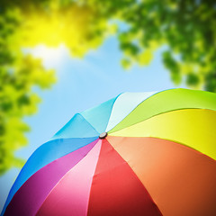 Rainbow umbrellas against the backdrop of nature