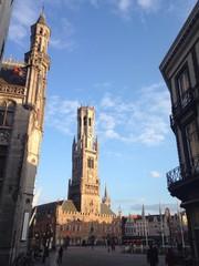 belfry and market square at bruges, belgium