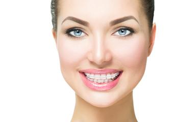 Beautiful woman smiling. Closeup ceramic braces on teeth