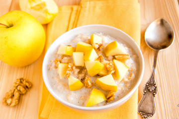 oatmeal porridge with apples, nuts