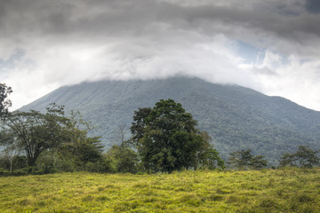Arenal volcano in Costa Rica half covered with clouds