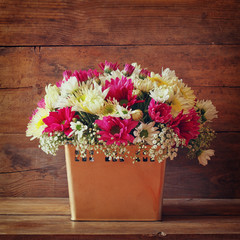 summer bouquet of flowers and on the wooden table