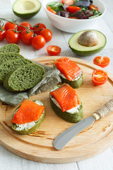 appetizer of salmon with avocado and cherry tomatoes