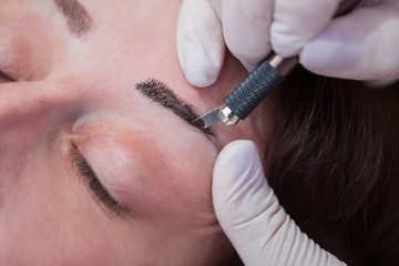 permanent make up on eyebrows,close up
