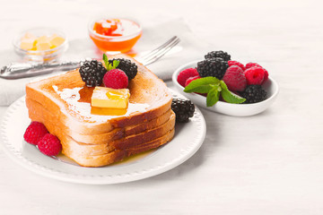 French toast with honey, butter and fresh berries