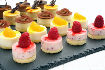 Tray with delicious catering cakes
