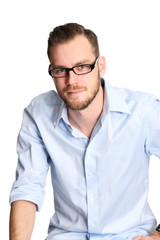Man sitting down wearing glasses and a blue shirt
