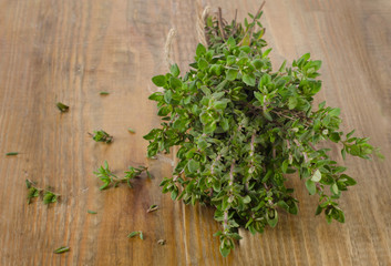 Thyme on a wooden table.