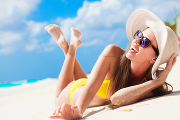 long haired girl in bikini having fun on tropical barbados beach