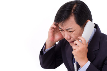 upset, frustrated manager receiving bad news via telephone call,