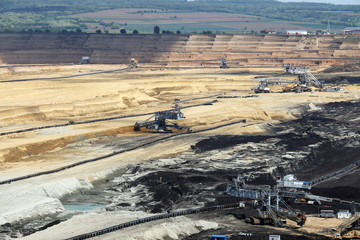 heavy excavators working on open pit coal mine