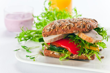 sandwich with grilled vegetables and chicken filet