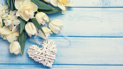 Background with fresh flowers and decorative heart