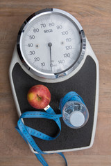 Bathroom scale isolated on brown  to check