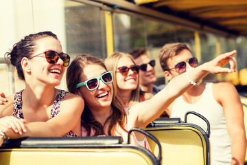 group of smiling friends traveling by tour bus Fototapete