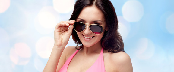 happy woman in sunglasses and swimsuit