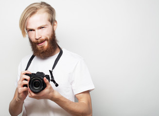 bearded man with a digital camera