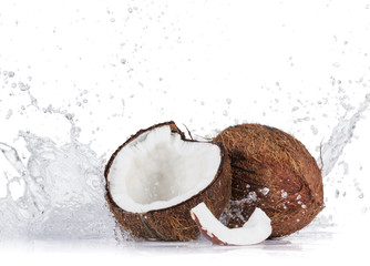 Cracked coconuts on white background