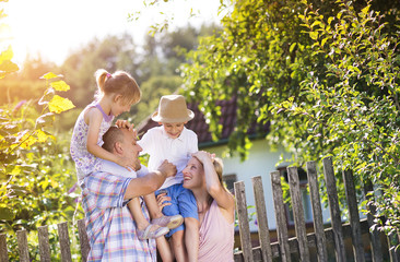 Happy young family spending time together in nature.