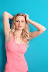 natural woman posing in blue wall