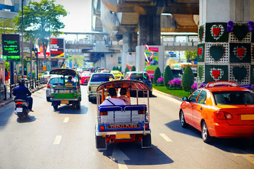 traditional vehicles moving on the main road in Bangkok