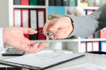 Realtor handing the keys to his client
