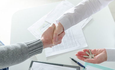 Realtor shaking hands with her client