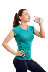 Young girl drinking water after her exercise