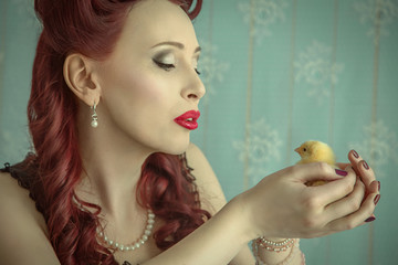 Pin-up girl kissing a chick