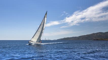 Sailing. Yacht sails with beautiful cloudless sky.