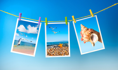 Sea pictures hanging on colorful pegs on blue background, collag