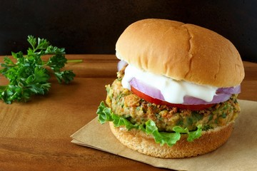 Falafel burger with lettuce, tomato, red onion and tzatziki