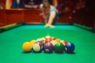 Billiard balls on green pool table
