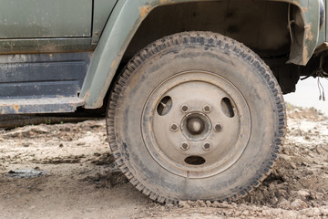 Muddy Dust Covered Vehicle Wheel