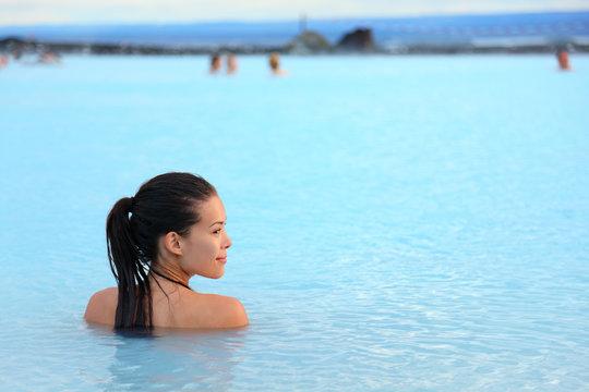 Geothermal spa - woman relaxing in hot spring pool