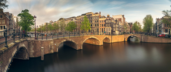 Panorama of beautifull Amsterdam canals with bridge, Holland