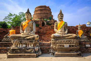 Buddha statues in blue sky