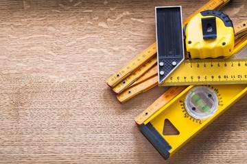 Working tools of measurement on oaken wooden board construction